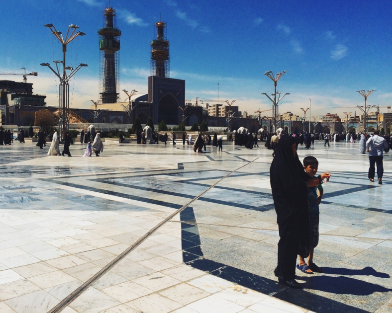 Iranian woman with her boy waiting at noon inside Imam Reza Shrine, Reza area