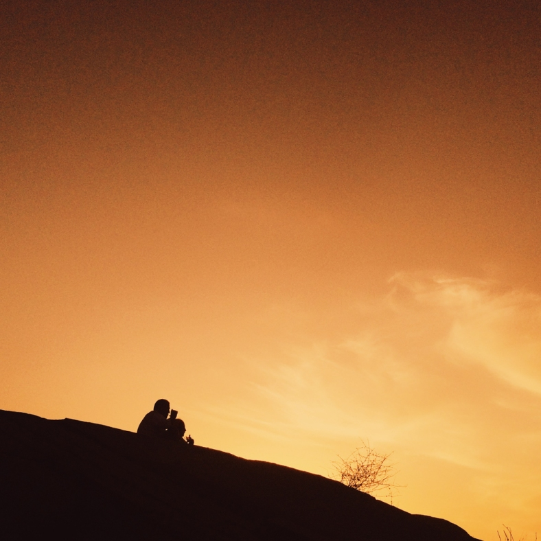 At the top of the mountain 2 Iranian men enjoying the sunset